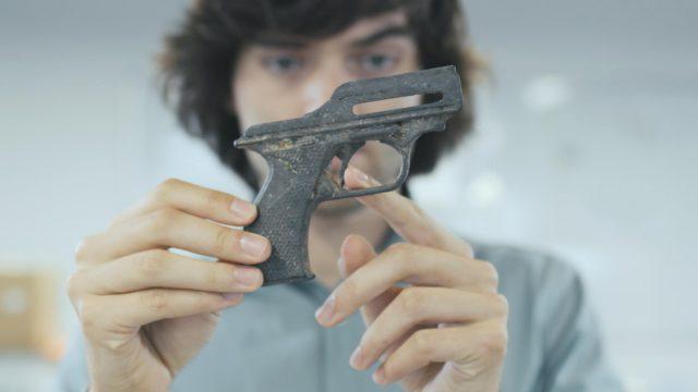 Boyan Slat holding a gun