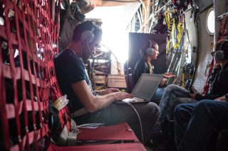 Lead Oceanographer Laurent Lebreton logging data aboard the Ocean Force One during the Aerial Expedition, 2016.