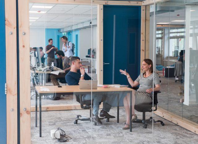 Lonneke Holierhoek (COO) discusses with Francesco Ferrari (Environmental Monitoring Coordinator) at The Ocean Cleanup Headquarters in Rotterdam, June 2018.