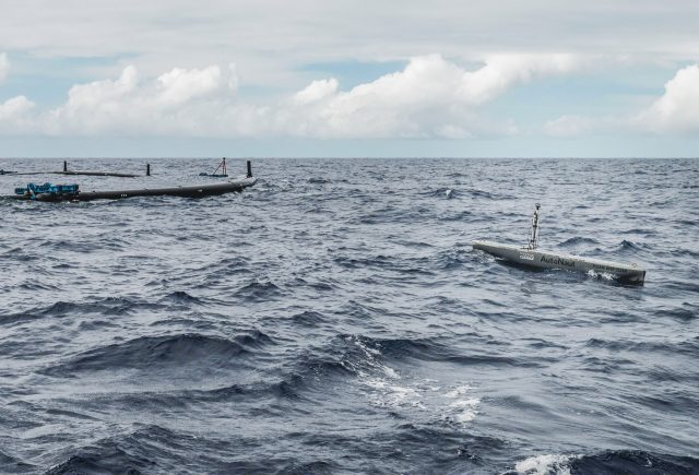 Environmental data collection using a remote vessel during the System 001 offshore mission.